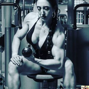 cute chick with muscular body and toned biceps image from facebook