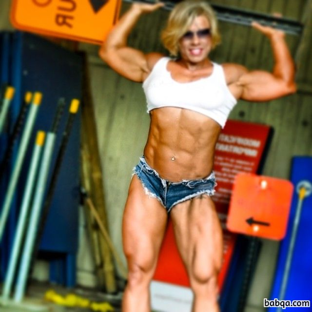 cute woman with muscular body and muscle arms post from instagram