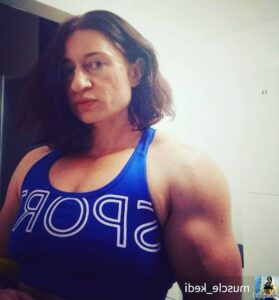 beautiful woman with strong body and toned biceps repost from reddit