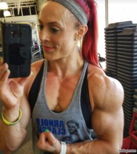 hottest woman with strong body and muscle biceps post from instagram