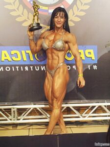 spicy woman with fitness body and muscle biceps picture from facebook
