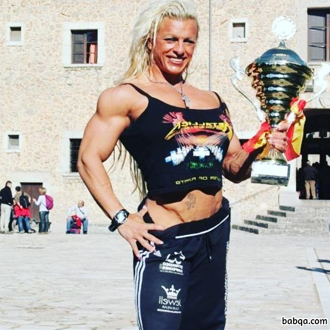 sexy woman with muscular body and muscle biceps image from reddit