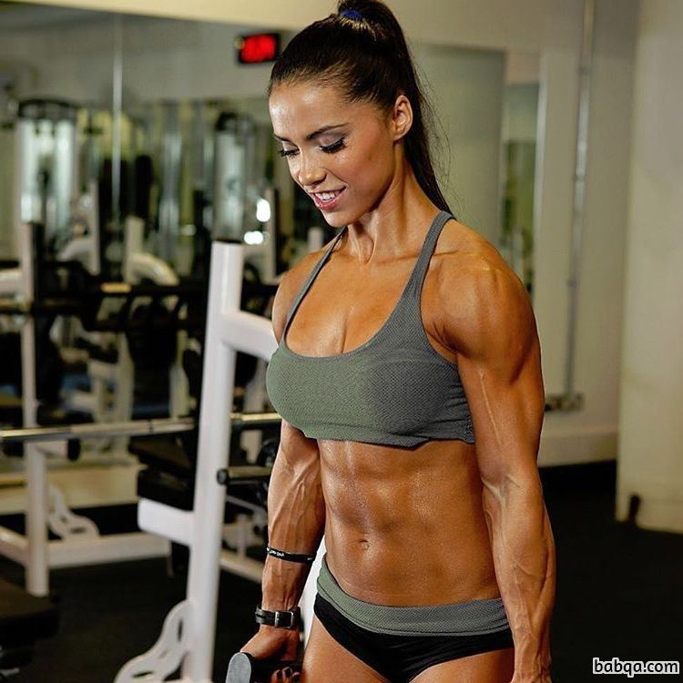 cute woman with fitness body and muscle biceps image from reddit