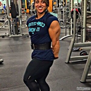 perfect female bodybuilder with fitness body and muscle biceps image from insta
