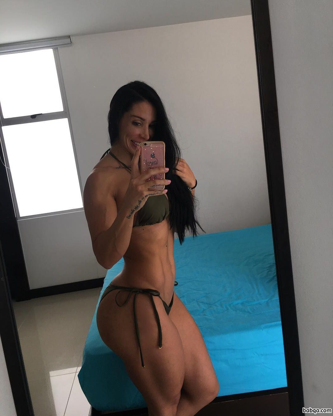beautiful female with strong body and muscle booty photo from insta