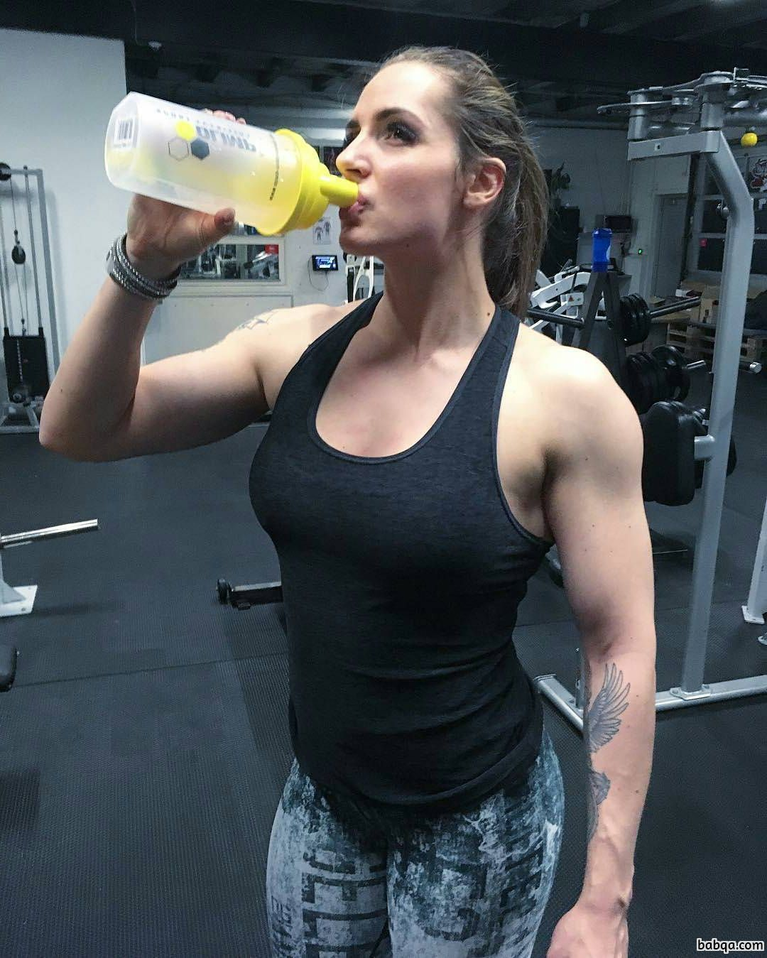 cute female bodybuilder with muscular body and muscle