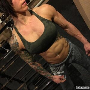 sexy woman with muscle body and toned biceps pic from g+