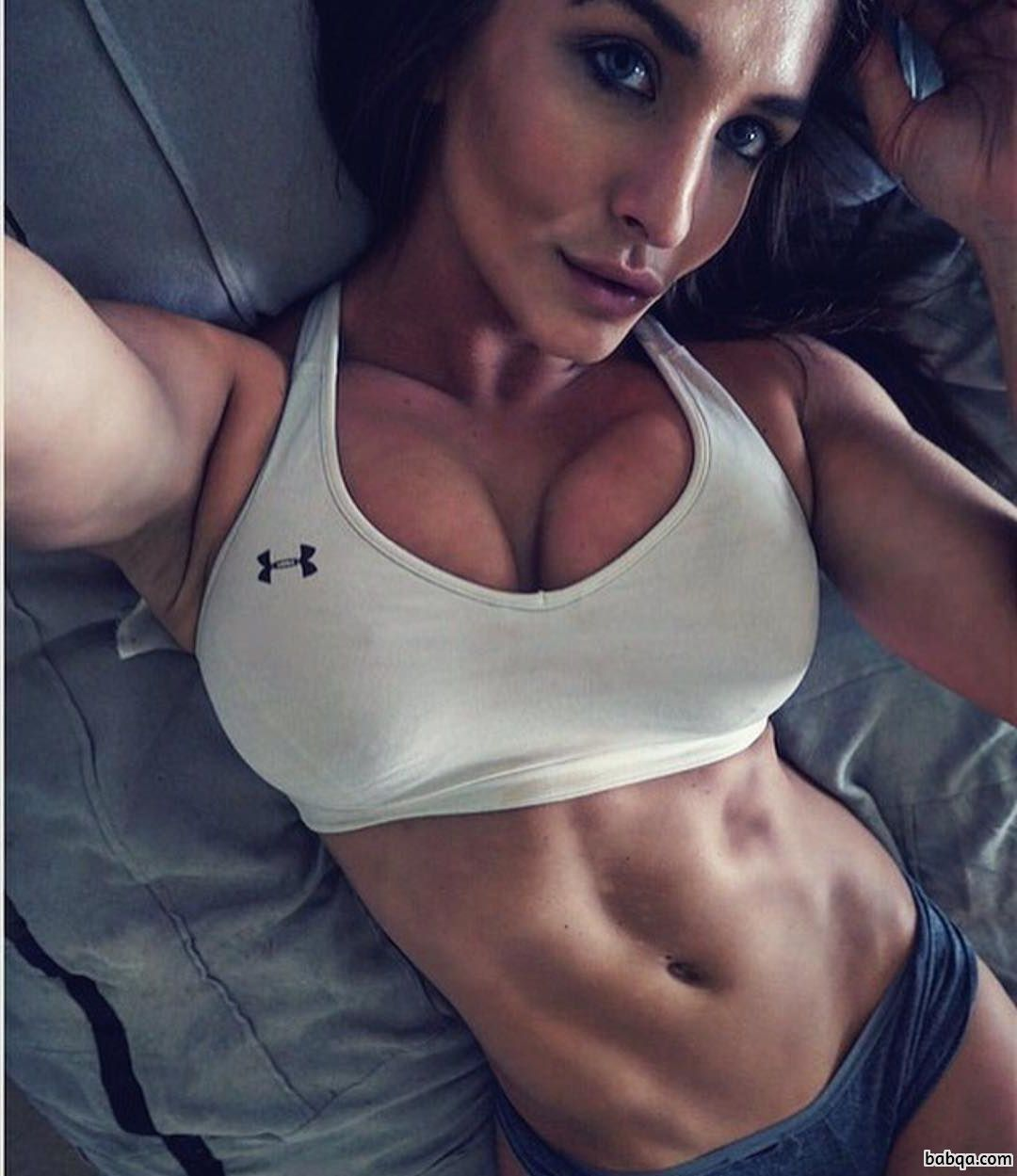 perfect female with fitness body and toned biceps post from instagram