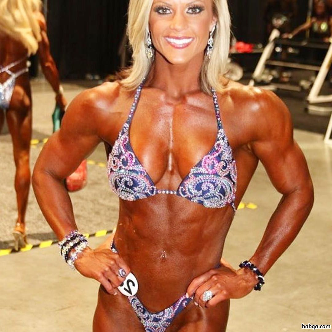 beautiful woman with strong body and muscle biceps image from reddit