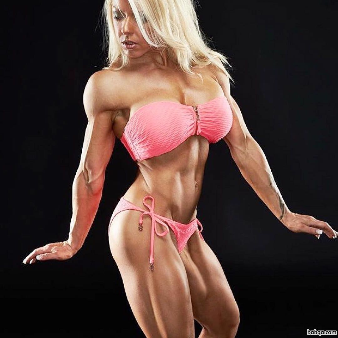 perfect female bodybuilder with muscle body and toned