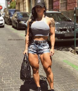 spicy female bodybuilder with muscle body and toned biceps repost from tumblr