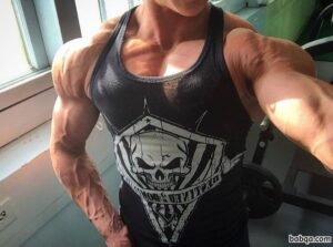 hot chick with fitness body and muscle biceps repost from tumblr