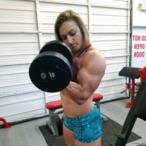 awesome babe with fitness body and muscle arms repost from linkedin