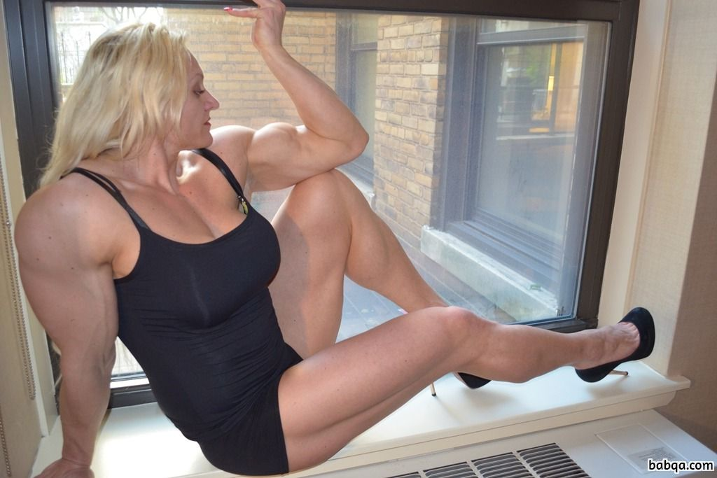 hottest female bodybuilder with strong body and muscle arms pic from reddit