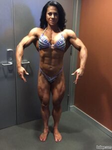 hot chick with muscle body and muscle biceps pic from insta