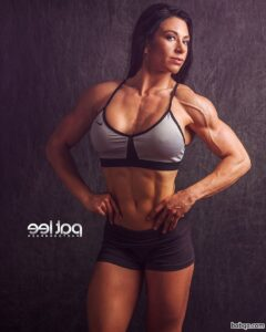 awesome babe with fitness body and muscle arms post from linkedin