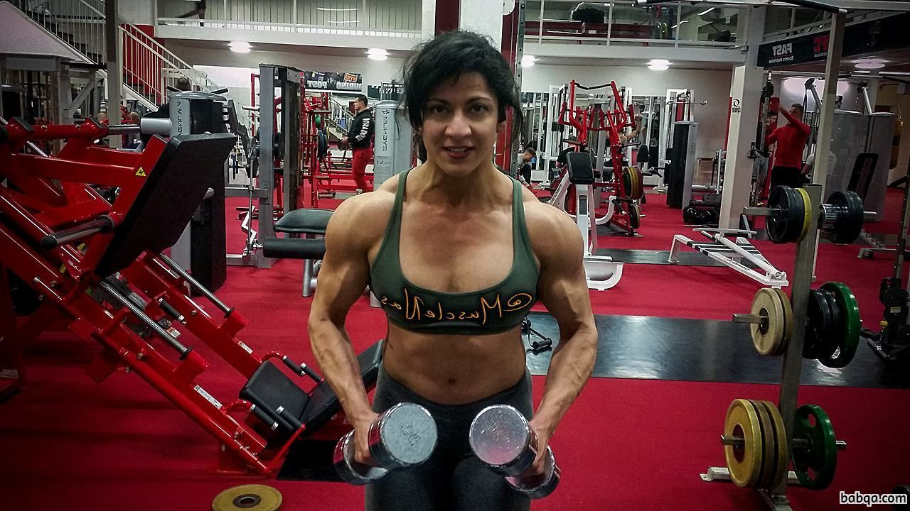 beautiful lady with fitness body and muscle biceps post from reddit