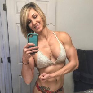 beautiful woman with fitness body and toned biceps pic from insta