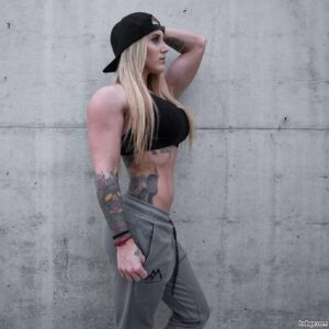 hot woman with strong body and muscle biceps image from instagram