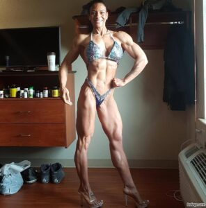 sexy female bodybuilder with muscular body and muscle booty post from insta