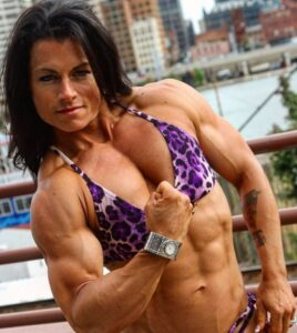 hottest lady with muscular body and toned biceps post from facebook