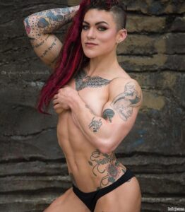 awesome female bodybuilder with strong body and muscle arms post from instagram