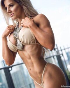 awesome girl with fitness body and muscle biceps picture from insta
