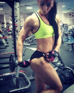 spicy lady with fitness body and toned biceps post from insta